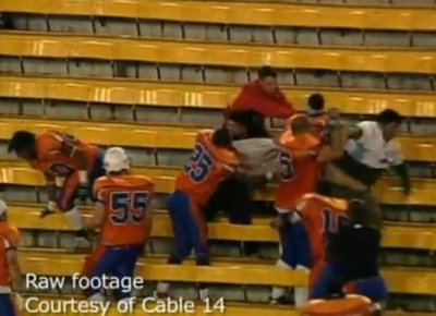 Brawl Breaks Out In Stands Between Football Players & Fans In Canada. Dudes Swinging Helmets, Milk Crates & Stomping Heads [Caught On Tape]