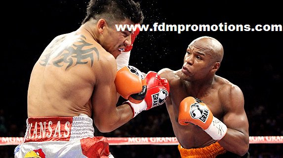 Floyd Mayweather Jr KOs Victor Ortiz In 4th Round or do you belive it was a cheap shout??