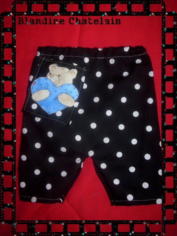 Pantalon noir a pois blanc