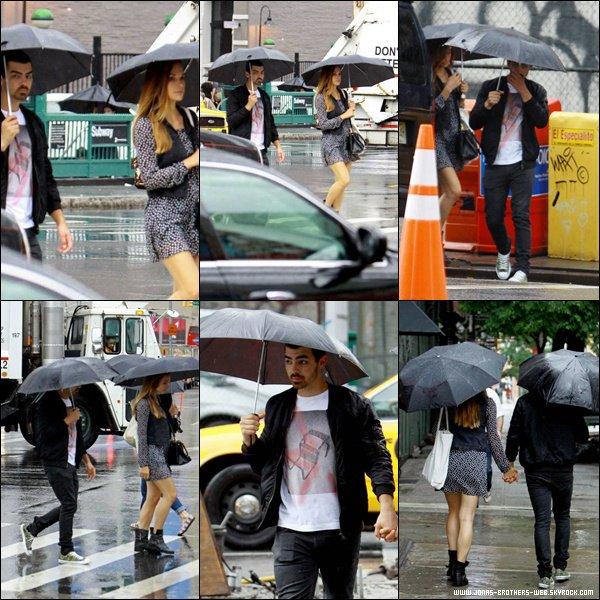 Le 01 Juillet 2013 | Joe et Blanda à Soho, sous la pluie, New York.
