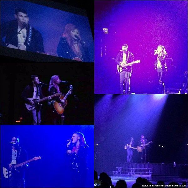 Le 08 Mars 2014 | Nick encore une fois sur le Neon Light Tour de Demi à Wallingford, Connecticut.