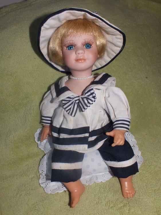 réparation d'une poupée en porcelaine