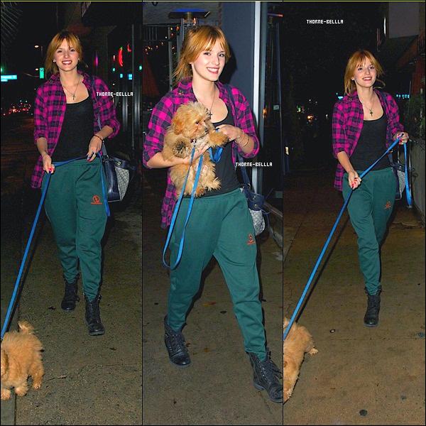 8/11/12: Bella en pleine promenade avec son chien a LA Top/Flop ?   pour moi un vrai Flop :p
