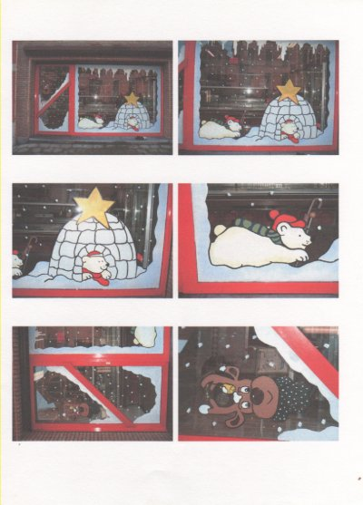 Décorations fenêtre d'une boucherie pour Noël.