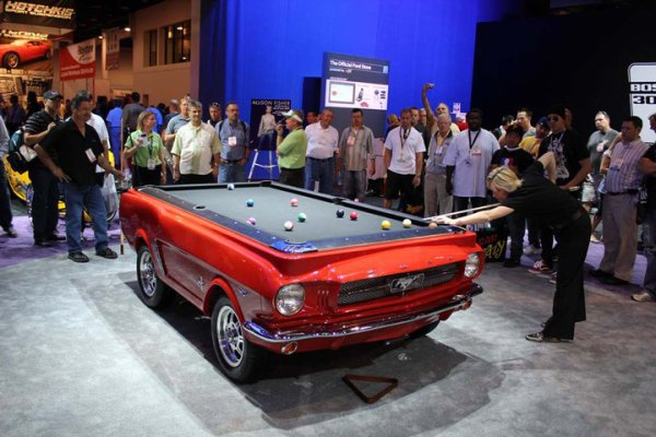 Best of SEMA 2010 - Allison Fisher shooting pool on a 64 and a half Mustang Pool Table