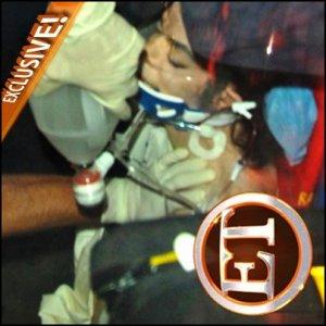 Première chose assez intrigante; L'ambulance & la photo de Michael.