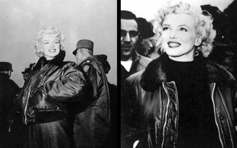 """Le lendemain matin, elle quitte la base de la """"7th infantery"""". Marilyn et Jean O'DOUL ont passé la nuit dans une tente VIP, où les soldats s'empresseront d'afficher un panneau """"Marilyn slept here - 16 february 1954"""" devant la tente. Marilyn a alors changé de tenue : bien qu'elle porte toujours aux pieds rangers hautes et un pantalon kaki, elle a enfilé un pull noir sous un blouson de l'armée, au col de fourrure, qu'elle laisse pourtant ouvert. Elle quitte la base, escortée par des officiers.  Elle se rend à la base de la """"3rd Infantery Division"""" où, dès son arrivée, elle est chaleureusement acceuillie par les soldats. Elle pose devant les photographes, amateurs comme professionnels, enlaçant ses bras autour des épaules des GIs, sourires aux lèvres, très heureux de rencontrer de près -et de toucher- cette star de cinéma d'Hollywood qu'ils adorent. Tous veulent une photo, puisqu'ils ont apporté leur appareil, enroulé autour de leur cou. Le froid commence à se faire ressentir pour Marilyn, car elle prend soin de fermer son blouson jusqu'au cou."""