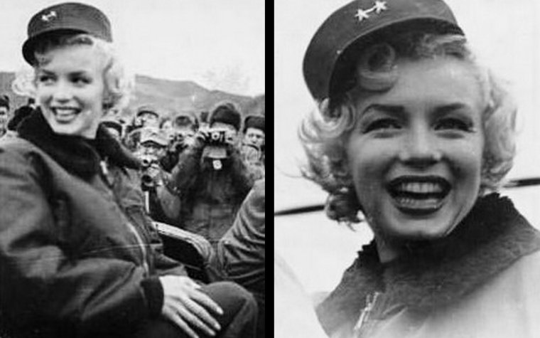 """Puis elle se rend à la base du """"160th Infantery Regiment"""", surnommée """"Grenadier Palace"""" et renommée """"MONROE Valley"""" pour l'occasion. Il pleut abondamment pendant que Marilyn chante et danse sur scène, vêtue de sa petite robe à paillettes. Et bien que la scène soit bien abritée, Marilyn chante au bord de l'estrade, sur la partie non abritée par la pluie, sans glisser sur le sol composé de planches de bois. Et il en faut plus aussi pour décourager les soldats qui l'attendent depuis des heures. Malgré le froid et la pluie, Marilyn et son public prennent du plaisir."""