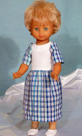 Couds une robe pour ta poupée.