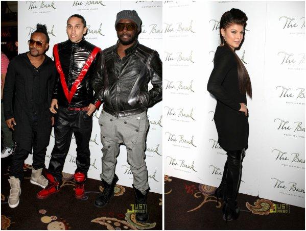 Les Black Eyed Peas à une soirée.