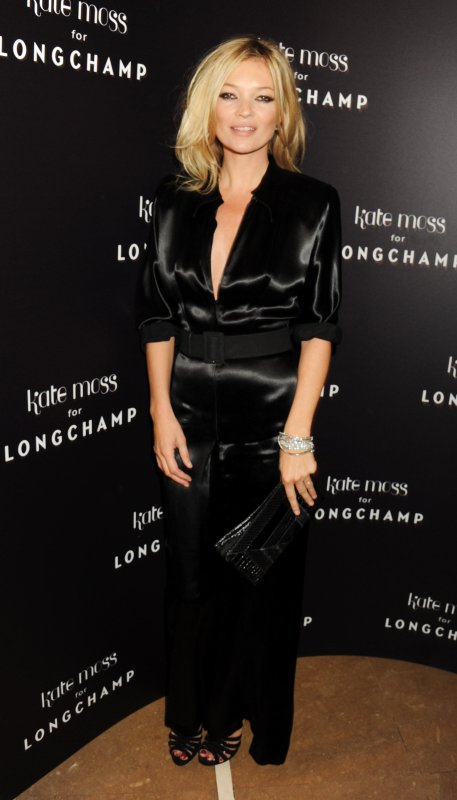 Kate Moss à une soirée de la marque Longchamp.