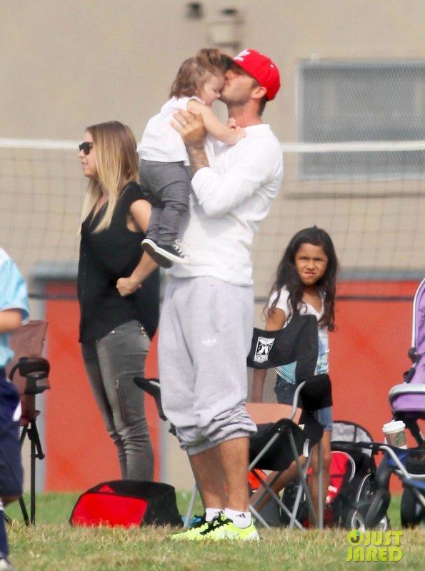 Les Beckham à un match de foot.