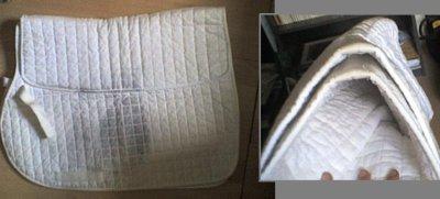 Tapis blanc, doublé au dos.