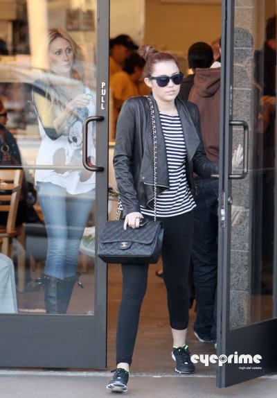 March 8, 2011 Miley Cyrus in spandex leaves a Cafe