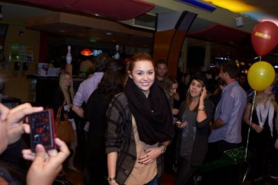 March 09, 2011 Miley Cyrus at 5th Annual Stars and Strikes Bowling event in LA