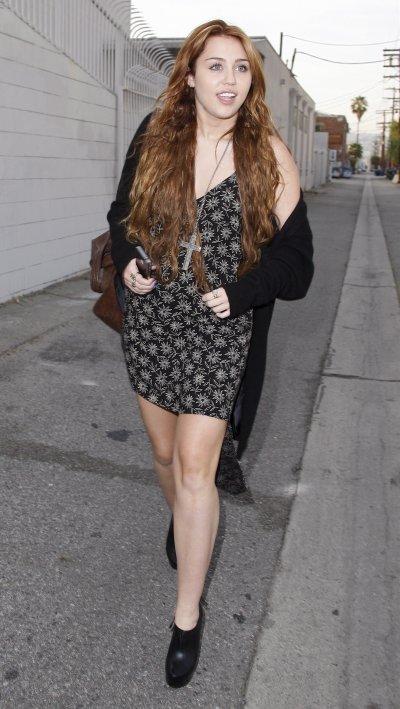 April 17, 2011 Miley Cyrus leaves American Rag in LA 23 PICS