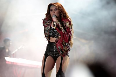 April 29, 2011 Miley Cyrus's Gypsy Heart Concert in Quito, Ecuador 7 Pics