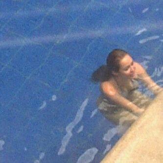 April 30, 2011 Miley Cyrus in a Bikini at The Swissotel Hotel in Quito, Ecuador