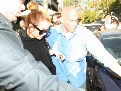 May 8, 2011 Miley Cyrus Leaving A Restaurant In Argentina (4 pics)