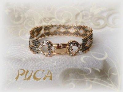 inscrivez-vous sur le blog de PUCA pour gagner ce magnifique bracelet... tirage le 25 décembre prochain...