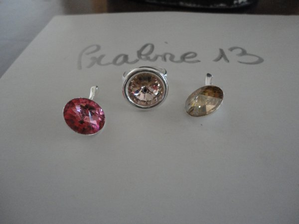 deux pendentifs et une bague en argent 925ème et cristal