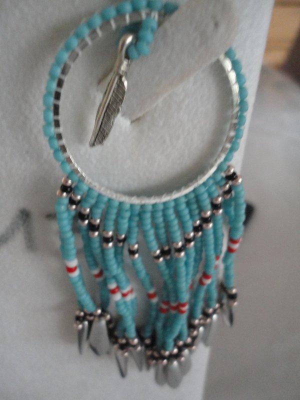 j'ai réalisé ce pendentif pour l'anniversaire de ma jumelle de perles Martine.