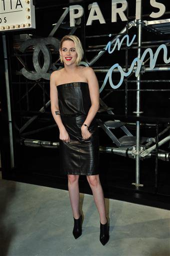 Kristen wears a black leather dress with bustier after the fall / winter 2015 Chanel shoes Styling by Tara Swennen, hair and makeup by Adir Abergel by Jillian Dempsey