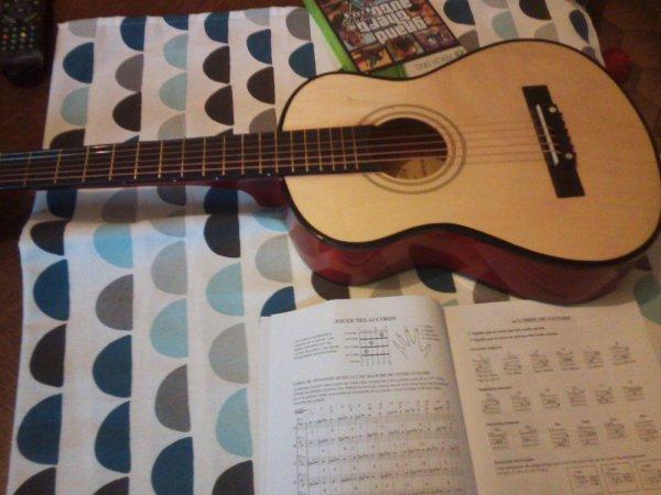 Je vous montre ma guitare