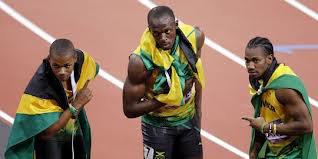 Les champions du 200m Usain Bolt, Yoan Blake and Warren Weir