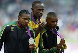 Usain Bolt médailler d'or, Yoan Blake médailler d'argent and Warren Weir médailler de bronze