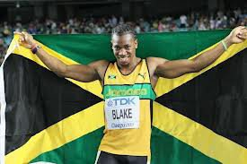 Yoan Blake avec le drapeau jamaicain