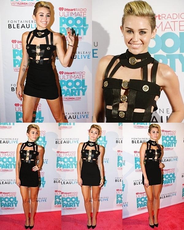 Le 29 juin 2013 •Miley était présente au iheartradio. Elle y a présenté un artiste. J'aime bien sa robe mais je n'aime pas sa coiffure.