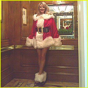 Heidi Klum shows off her legs for days in a sexy Santa costume
