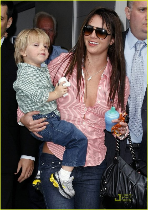 Britney Spears is all smiles as she carries son Jayden James, 3, after landing at the airport in Copenhagen, Denmark on Saturday (July 11)