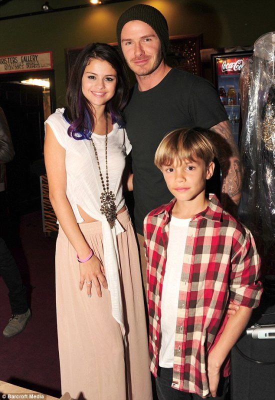 Nice one, Dad! David Beckham takes his boys to meet teenage dream Selena Gomez