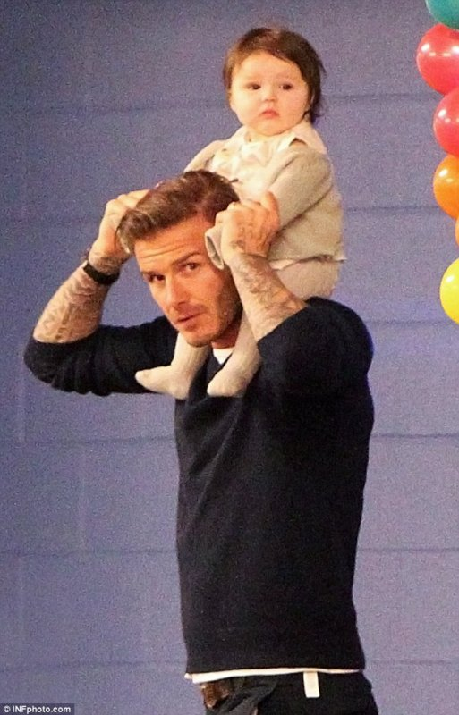 David Beckham carries Harper at the Lucky Strike Lanes to go bowling for Cruz's 7th birthday