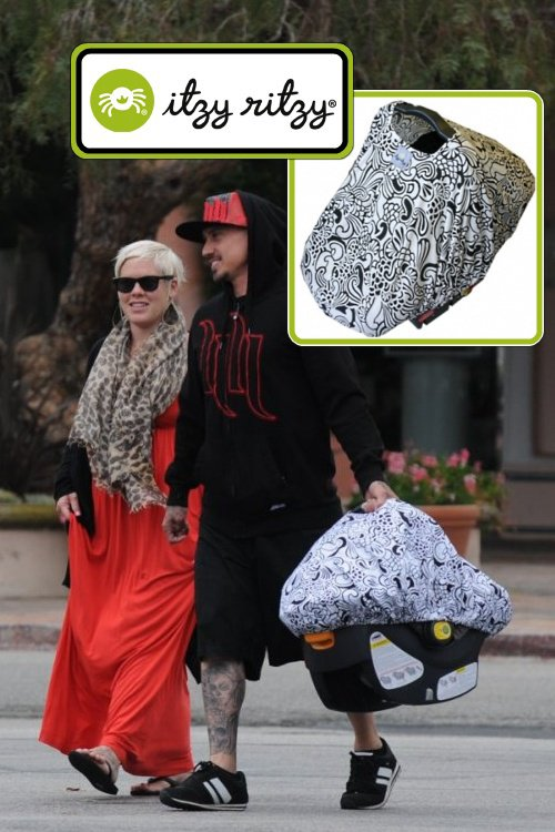 Willow's carseat is covered with an Itzy Ritzy Peek-A-Boo Pod in Licorice Swirl – $29.99