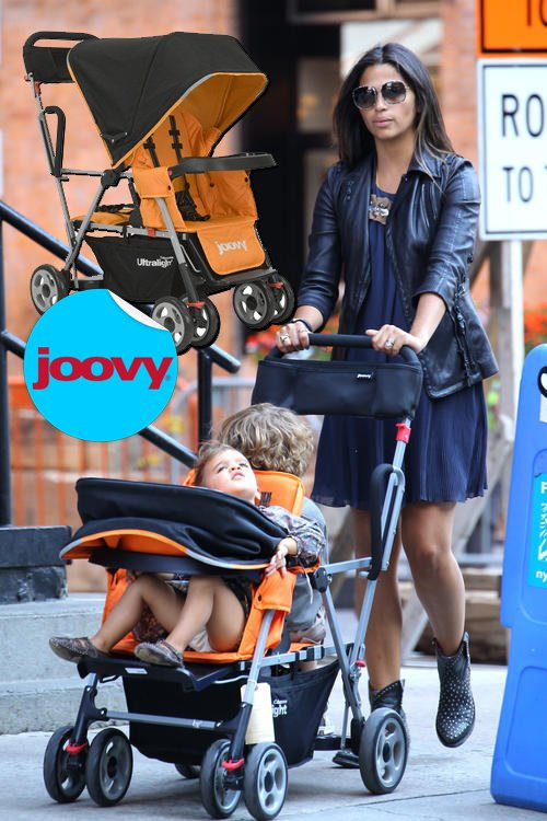 Vida and Levi ride in a Joovy Caboose Ultralight Stand On Tandem Stroller – $239.99
