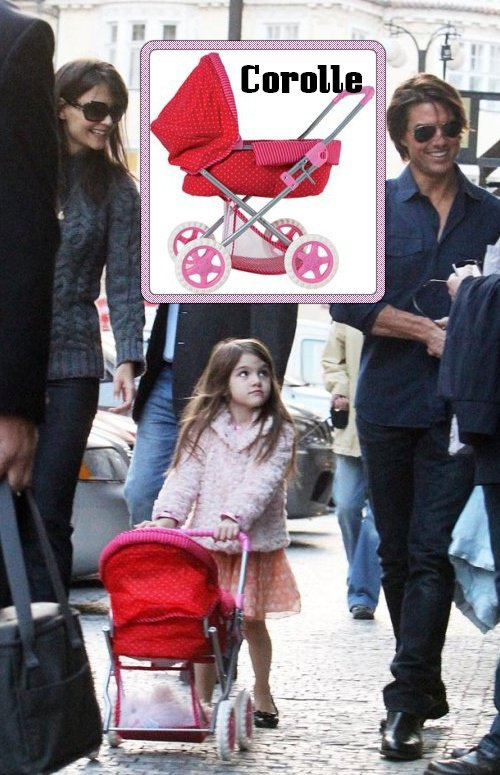 Suri pushes a Corolle Red and Fuchsia Doll Carriage – $66.50