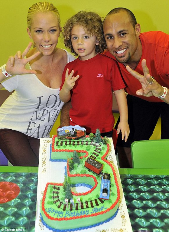 Kendra Wilkinson and NFL hubby Hank Baskett are ready to party as they pose with their three-year-old son Hank Jr. at his birthday party on Thursday