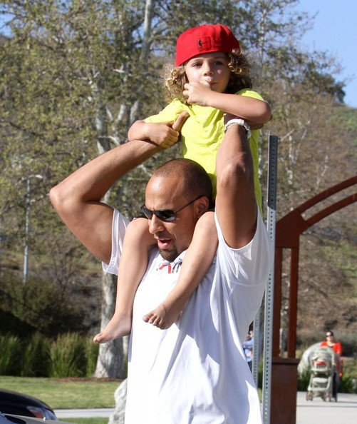 Reality TV star Kendra Wilkinson, her husband Hank Baskett, and their son Hank Jr play at park in Calabasas, California on March 16, 2013