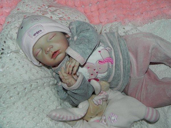 Bébé d'Amour baptisé Flora merci a Marie Rose sa maman