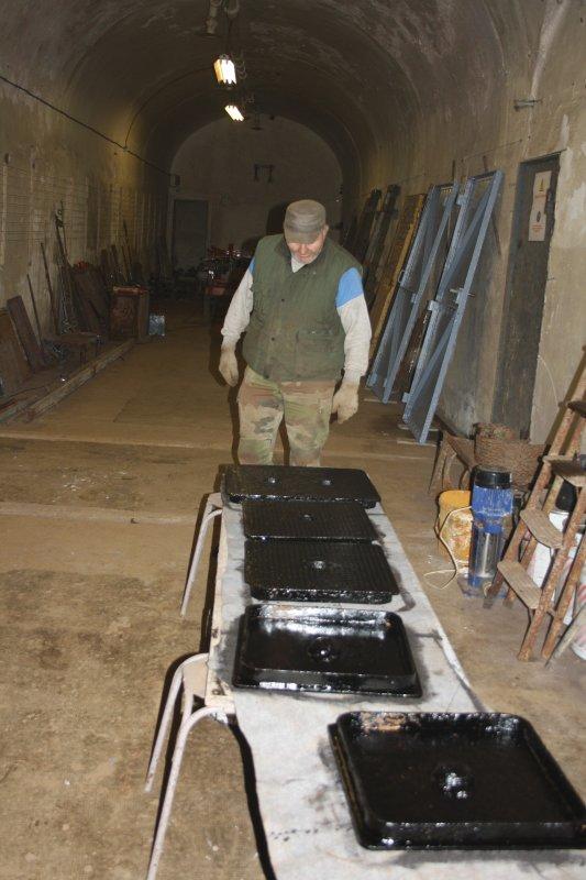 Mise en peinture de plaques d'égout