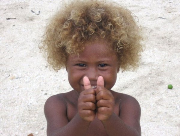 http://www.odditycentral.com/news/black-and-blond-the-origin-of-blond-afros-in-melanesia.html