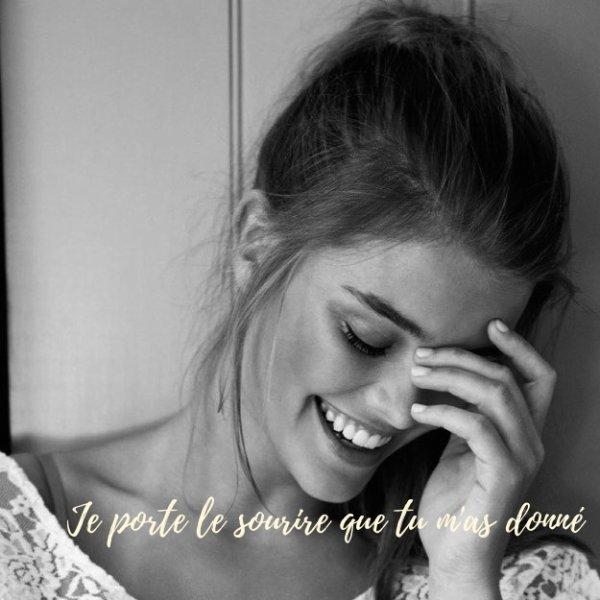 Je porte le sourire que tu m'as donné.