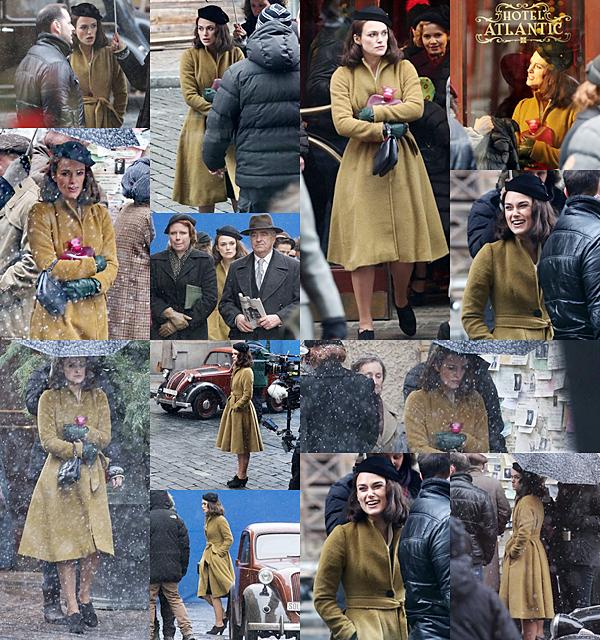 """16 Janvier 2017 Keira a été vue sur le tournage de son nouveau film """"The Aftermath"""" à Prague ! Elle a tourné une scène de nuit dans une magnifique robe en soie jaune, et une scène de jour. Il a l'air de faire très froid là bas ! La neige s'est même invitée sur le tournage. Entre les scènes, Keira portait une grosse doudoune, des après ski et une bouillotte pour se réchauffer."""