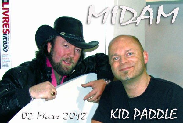 Michel Ledent, dit MIDAM, est un auteur de bandes dessinées belge, né le 16 mai 1963.