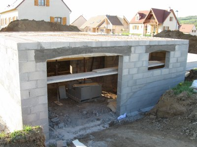 Mur maison babeau seguin neuvilliere for Construction garage parpaing