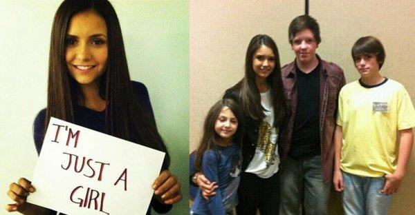 """Des photos twitter de Nina, où elle tient une pancarte : """" Je suis juste une fille """""""