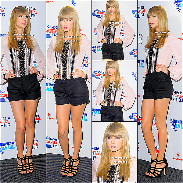 .09.06.13 : Taylor Swift vu au CAPITAL FM SUMMERTIME BALL 2013 sur le tapis dans Londres . .